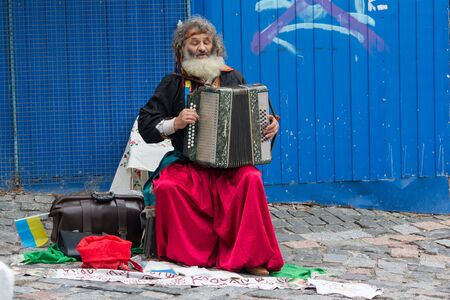 Kiev, Ukraine - August 24, 2016: Street musician playing the accordion on the street St. Andrews Descent