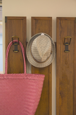 furniture store: Bag and hat on the rack in the hallway. Interior