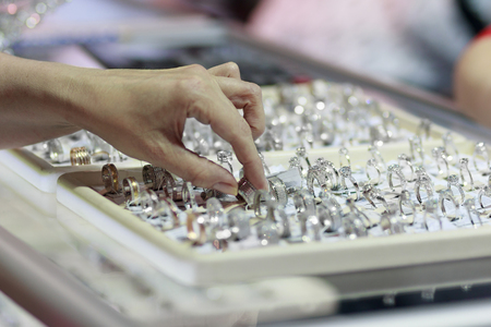 Buyer's hand and counter with jewelry. Sale Standard-Bild