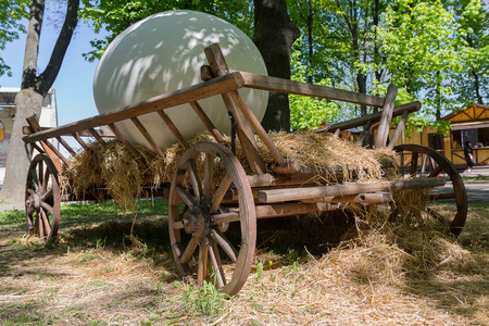giant easter egg: Wooden cart with big egg. Easter decorations Stock Photo