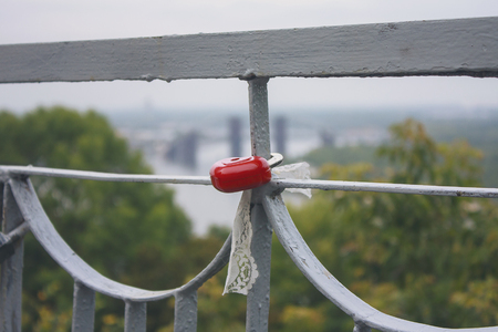 fastened: Red lock fastened to the railing. Love