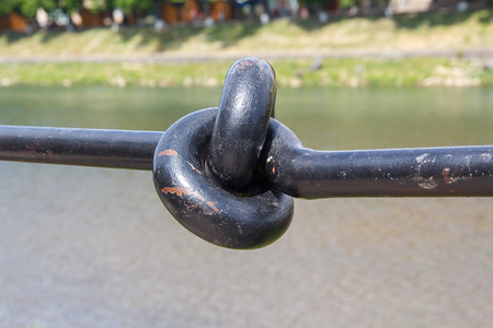 Metal handrail folded in a knot closeup. Architecture Stock Photo