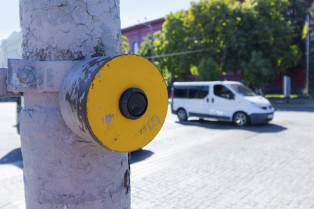 visually: Yellow signal button for the blind at the junction of the road