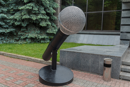 Scenery in the form of a large microphone. Architecture