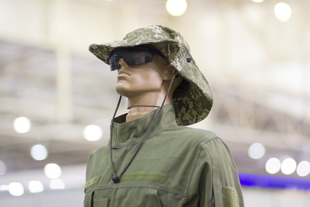 Mannequin in uniform and wearing a hat with a wide brim Stock Photo