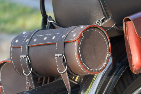cleaning service: Leather equipment on a motorcycle closeup. Life style