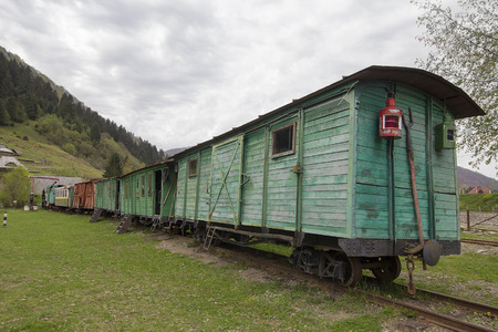 Old Soviet wooden wagon narrow-gauge railway. Transport