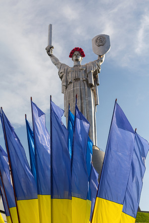 Mother Motherland statue decorated with red poppy flower wreath on Victory Day in Kiev, Ukraine