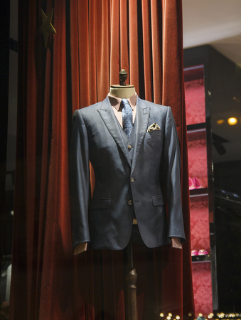 tailored: Male mannequin wearing a suit and accessories. Sale