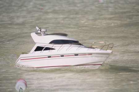 Model luxury yacht in accepted Swimming pool. Ship modeling Stock Photo