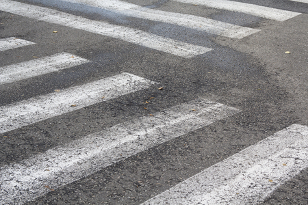 strips away: Intersecting marking the transition band on the pavement. Backgrounds and textures Stock Photo