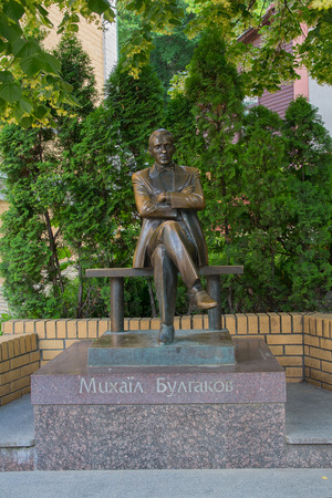 Kiev, Ukraine - June 04, 2016: Monument to the famous writer Mikhail Bulgakov in the Andreevsky Descent
