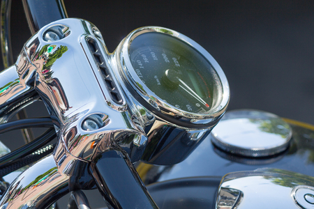 Chromed speedometer retro motorcycle closeup. Transport