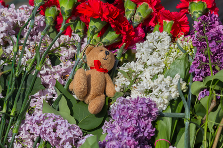 Toy among the flowers on the memorial of soldiers who died during the Second World War