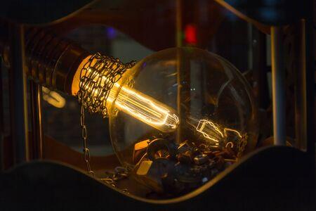 Illuminated electric lamp in a retro style closeup Stock Photo
