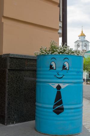 Stylized flower bed on the city sidewalk. Decoration