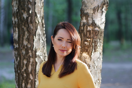 30 s: Portrait of a beautiful woman on a forest background. People