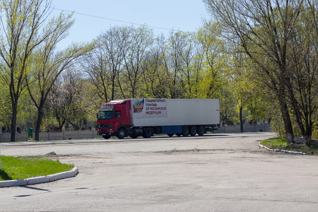 Makeevka, Ukraine - April 27, 2017: Truck with humanitarian cargo on the city road. The inscription on the car Humanitarian Aid from the Russian Federation in Russian Editorial