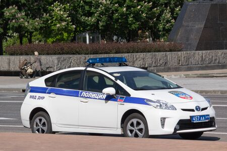 lightbar: Donetsk, Ukraine - May 17, 2017: Police patrol car with the symbol of the self-proclaimed Donetsk Peoples Republic on the city street