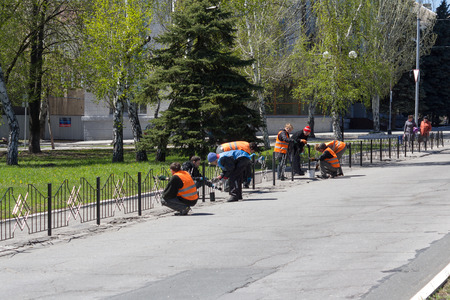 Makeevka, Ukraine - April 27, 2017: Communal workers clean the city in the territory controlled by the Donetsk Peoples Republic