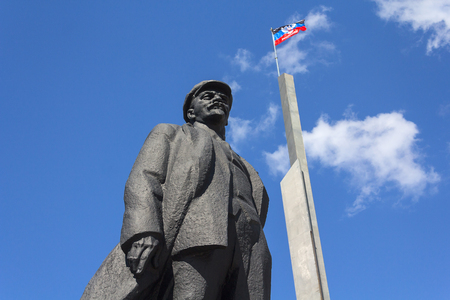 separatism: Donetsk, Ukraine - May 17, 2017: Monument to Vladimir Lenin and the flag of Donetsk Peoples Republic on the central square of the city