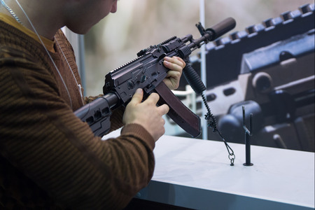 Man with an automatic rifle at the counter. Weapons