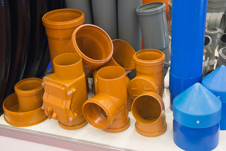 Colored plastic water pipes at the exhibition. Industry