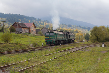 Train in the countryside lit by the sun. Carpathians, Ukraine
