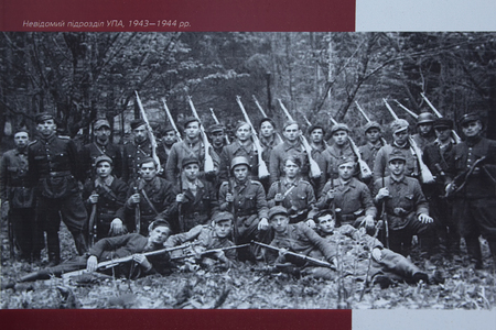 museum rally: Kiev, Ukraine - June 10, 2017: Photo of partisans of the Ukrainian Insurgent Army in an outdoor exhibition near the National Museum of Ukrainian History. The inscription on the photo: Unknown unit of the UPA, 1943-1944 in the Ukrainian language Editorial