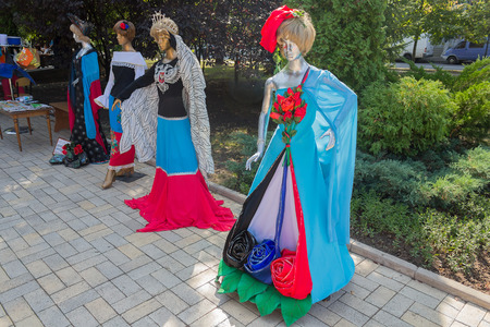 Donetsk, Ukraine - August 27, 2017: Samples of clothing models with national symbols in the center of the city during the celebration of the citys day