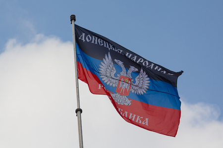 Donetsk, Ukraine - August 27, 2017: Flag of the self-proclaimed Donets Peoples Republic on the central square of the city