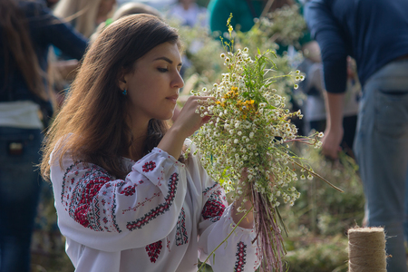Kiev, Ukraine - July 06, 2017: Girl wreathes a wreath of herbs and flowers at the festival in honor of the national holiday of Ivan Kupala