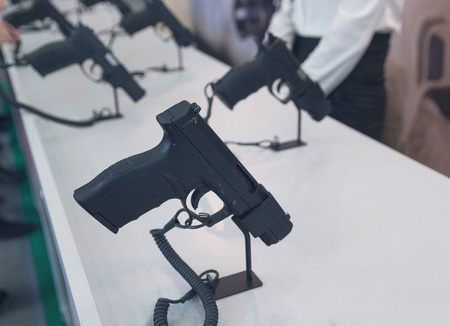 Pistols in a row on the counter. Weapons