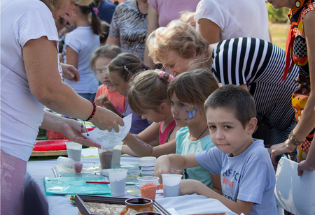 Makeevka, Ukraine - August 26, 2017: Children on a masterclass in drawing on the celebration of the citys day in the territory of the self-proclaimed Donetskoy republic