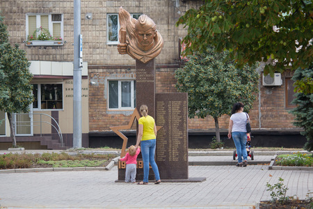 Makeevka, Ukraine - August 24, 2017: Residents of the city near the monument to the soldiers of the Red Army who died in the Second World War in the central square