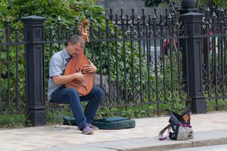 bard: Kiev, Ukraine - July 16, 2017: Street musician Ukraine tradition instrument