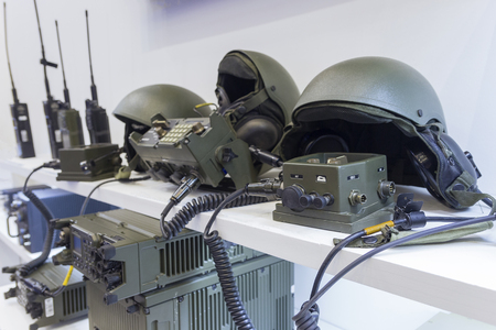 Military helmet and electronics at the exhibition. Weapons
