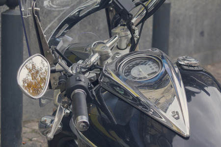 Dashboard and gas tank of a classic motorcycle close-up. Transport Stock Photo