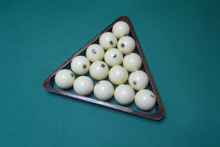 Billiard balls in the triangle on the table
