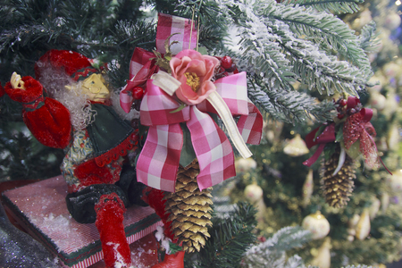 Christmas toy as a troll on the trees. Christmas decorations Stock Photo