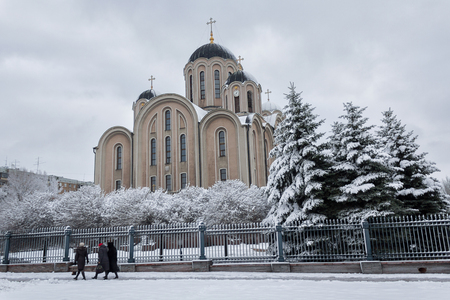Makeevka, Ukraine - November 2, 2017: Church of the Cathedral of St. George and parishioners in winter