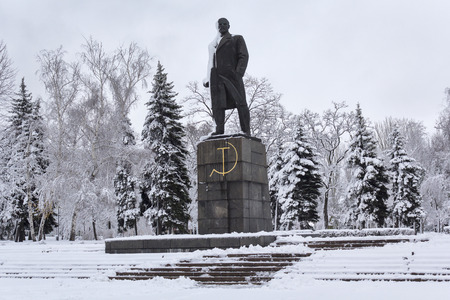 Monument to the communist leader Lenin in a snow-capped city. Makeevka, Ukraine