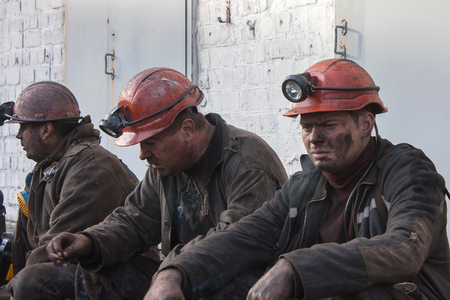 Makeevka, Ukraine - October 30, 2012: Miners of the mine Yasinovskaya-Glubokaya smoke after the robochy shift