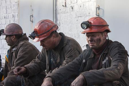 Makeevka, Ukraine - October 30, 2012: Miners of the mine Yasinovskaya-Glubokaya smoke after the robochy shift