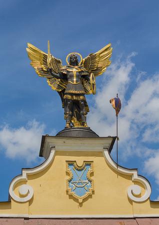 Kiev, Ukraine - June 21, 2017: Gold plated bronze statue of Archangel Michael Saint patron of Kiev in independence square