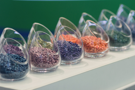 Multicolored seeds on the exhibition stand. Agriculture