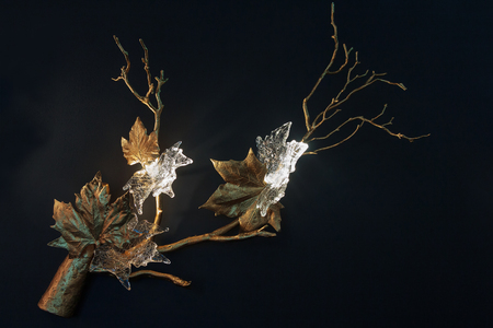 Luxurious luminaire in the form of leaves and flowers on the wall. Interior
