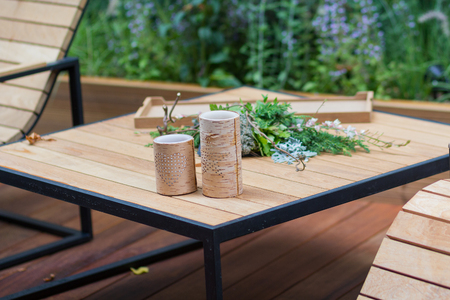 Natural wooden armchairs on patio for relaxation. Interior Archivio Fotografico
