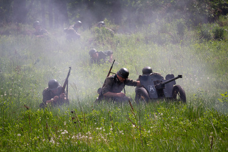 Wehrmacht soldiers with anti-tank guns fighting. Historical Reconstruction