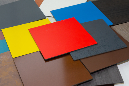Multi-colored samples of composite materials for the ventilated facades in showroom. Construction 스톡 콘텐츠